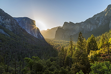 Morning view of sun peaking round El Capitan, Yosemite National Park, UNESCO World Heritage Site, California, United States of America, North America