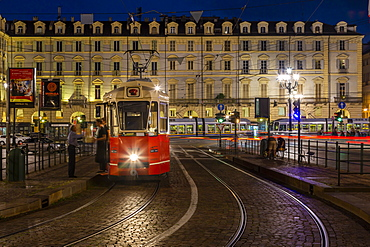 View of tram in Piazza Castello at dusk, Turin, Piedmont, Italy, Europe