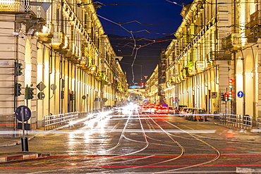 View of Via Roma and Porta Nuova Railway Station at night, Turin, Piedmont, Italy, Europe