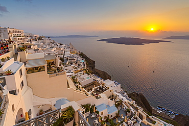 View of white washed houses and Mediterranean sea at sunset, Fira, Firostefani, Santorini (Thira), Cyclades Islands, Greek Islands, Greece, Europe