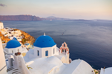 View of blue domes of churches in Oia village, Santorini, Cyclades, Aegean Islands, Greek Islands, Greece, Europe