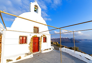 View of white washed hilltop church in Oia village, Santorini, Cyclades, Aegean Islands, Greek Islands, Greece, Europe