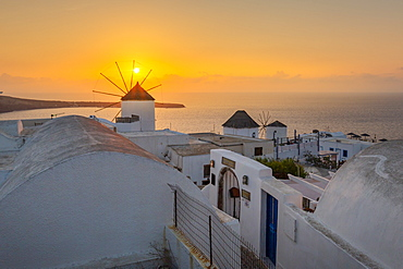 View of windmills at sunset in Oia village, Santorini, Cyclades, Aegean Islands, Greek Islands, Greece, Europe