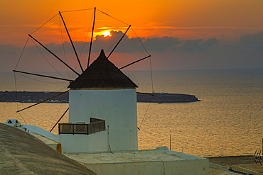View of windmill at sunset in Oia village, Santorini, Cyclades, Aegean Islands, Greek Islands, Greece, Europe