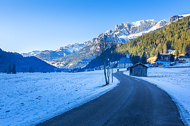 Road through snow under Dolomites Italy, Europe