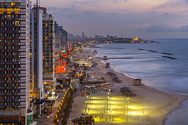 Elevated view of the beaches and hotels at dusk, Jaffa visible in the background, Tel Aviv, Israel, Middle East