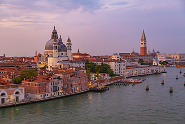 View of Venice skyline from cruise ship at dusk, Venice, UNESCO World Heritage Site, Veneto, Italy, Europe