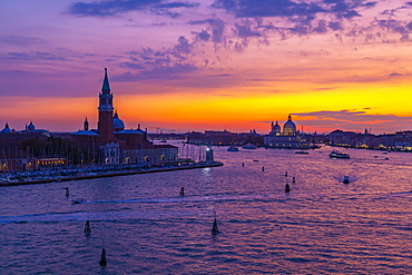 View of Venice skyline and red sky from cruise ship at dusk, Venice, UNESCO World Heritage Site, Veneto, Italy, Europe