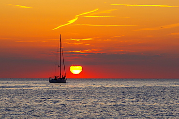 View of sunset and sailboat on Adriatic Sea from the old town, Rovinj, Istria, Croatia, Adriatic, Europe