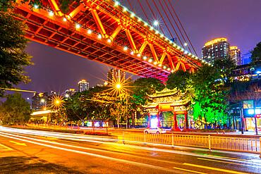 View of Masangxi Bridge and buildings near Arhat Buddhist Temple at dusk, Yuzhong District, Chongqing, China, Asia