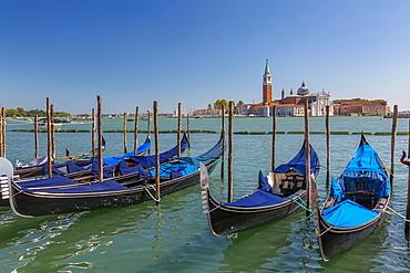 View of gondolas and San Giorgio Maggiore and Lido, Venice, UNESCO World Heritage Site, Veneto, Italy, Europe