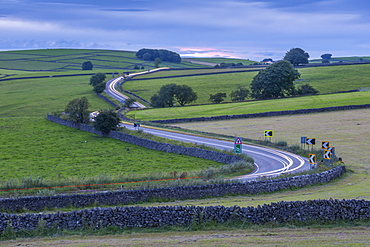 View of trail lights on winding road near Tideswell, Peak District National Park, Derbyshire, England, United Kingdom, Europe