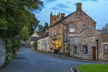 View of village houses and St. Giles' Church at dusk, Hartington, Peak District National Park, Derbyshire, England, United Kingdom, Europe