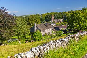 View of village church and dry stone walls, Hartington, Peak District National Park, Derbyshire, England, United Kingdom, Europe