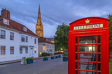 View of Salisbury Cathedral and red telephone box at dusk, Salisbury, Wiltshire, England, United Kingdom, Europe