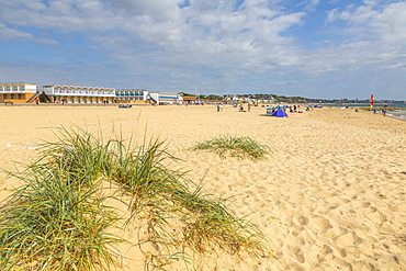 View of beach huts overlooking Sandbanks Beach in Poole Bay, Poole, Dorset, England, United Kingdom, Europe