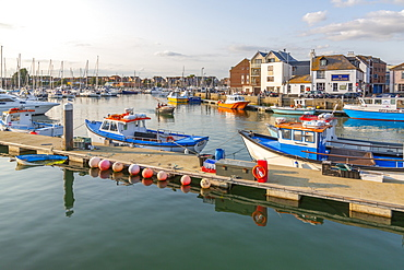 View of harbour boats and quayside houses, Weymouth, Dorset, England, United Kingdom, Europe