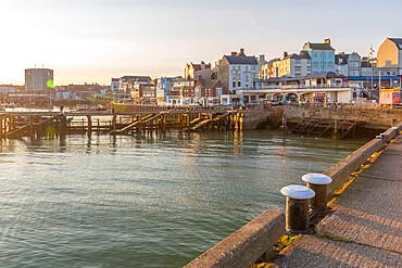 View of harbourside shops in Bridlington Harbour at sunset, Bridlington, East Yorkshire, England, United Kingdom, Europe