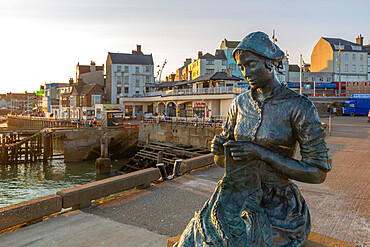 View of the Gansey Girl statue and harbour at sunset, Bridlington, East Yorkshire, England, United Kingdom, Europe