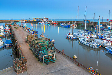 View of harbour boats in Bridlington Harbour at dusk, Bridlington, East Yorkshire, England, United Kingdom, Europe