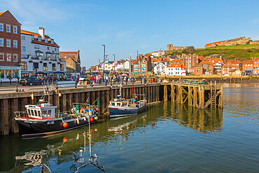 View of St. Mary's Church, houses and boats on the River Esk, Whitby, Yorkshire, England, United Kingdom, Europe