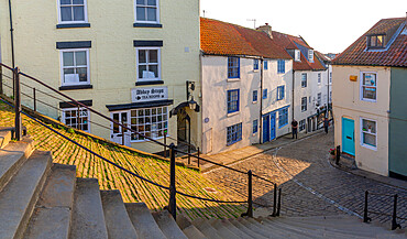 View of cobbled street and Whitby from 199 steps leading to St Mary's Church, Whitby, Yorkshire, England, United Kingdom, Europe