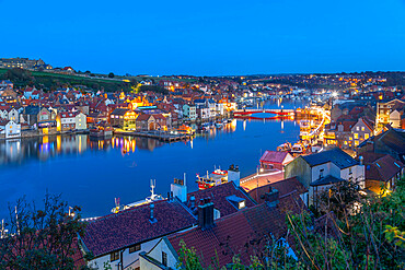 View of Whitby Bridge from across River Esk at dusk, Whitby, Yorkshire, England, United Kingdom, Europe