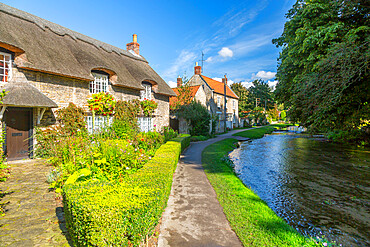 View of riverside cottages and Thornton Beck, Thornton Dale, North Yorkshire, England, United Kingdom, Europe