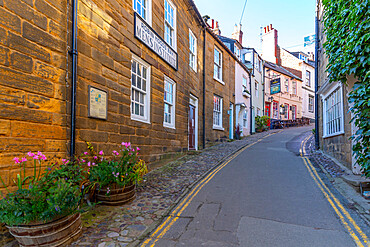 View of pastel coloured houses on King Street in Robin Hood's Bay, North Yorkshire, England, United Kingdom, Europe