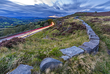 View traillights toward Hathersage from Lawrencefield during autumn, Hathersage, Hope Valley, Derbyshire Peak District, Derbyshire, England, United Kingdom, Europe