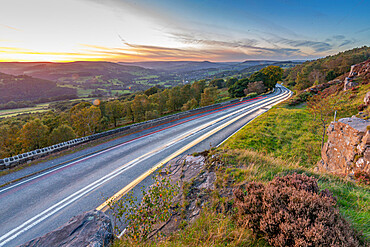 View of car trail lights from Surprise View at sunset, Millstone Edge, Derbyshire Peak District, England, United Kingdom, Europe