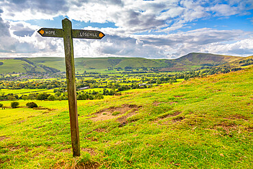 View of signpost and Hope Valley, Derbyshire Peak District, England, United Kingdom, Europe