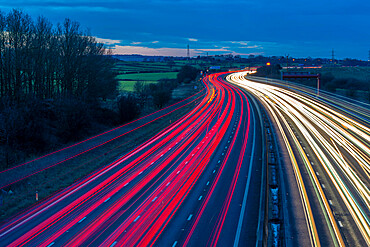 View of traffic trail lights on M1 motorway near Chesterfield, Derbyshire, England, United Kingdom, Europe