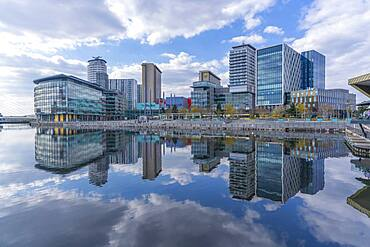 View of MediaCity and clouds reflecting in water in Salford Quays, Manchester, England, United Kingdom, Europe - 844-23631