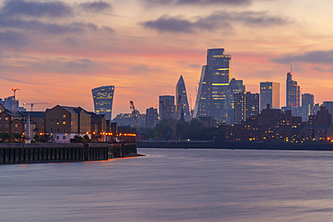 View of The City skyline at sunset from the Thames Path, London, England, United Kingdom, Europe