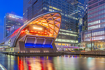 View of the Crossrail Station in Canary Wharf and tall buildings at dusk, London, England, United Kingdom, Europe
