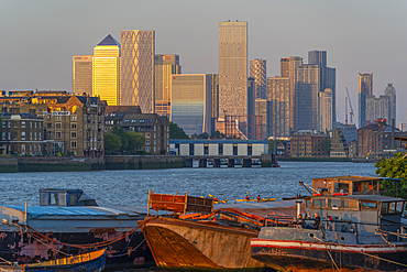 View of Thames barges, Docklands and Canary Wharf at sunset, London, England, United Kingdom, Europe