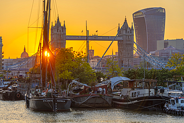 View of Tower Bridge and the City of London in the background at sunset, London, England, United Kingdom, Europe