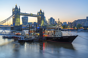View of Tower Bridge and the City of London in the background at dusk, London, England, United Kingdom, Europe