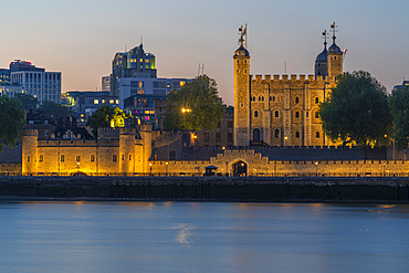 View of the Tower of London and river Thames at dusk, London, England, United Kingdom, Europe