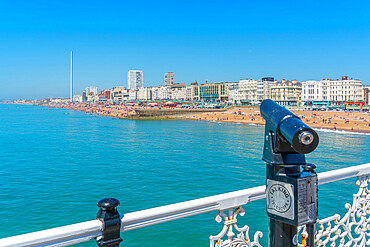 View of beach and telescope on a sunny day from Brighton Palace Pier, Brighton, East Sussex, England, United Kingdom, Europe