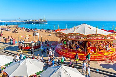 View of sea front carousel and Brighton Palace Pier, Brighton, East Sussex, England, United Kingdom, Europe