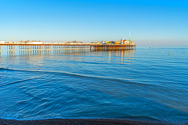 View of sea front and Brighton Palace Pier in late afternoon sunshine, Brighton, East Sussex, England, United Kingdom, Europe
