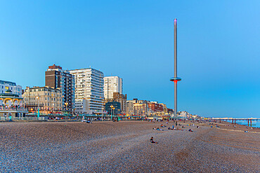 View of beach and British Airways' i360 viewing tower at dusk, Brighton, East Sussex, England, United Kingdom, Europe