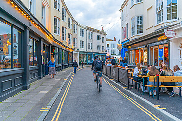 View of cafes and restaurants, Alfresco dining in The Lanes at dusk, Brighton, Sussex, England, United Kingdom, Europe