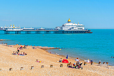 View of Eastbourne Pier and beach in summer time, Eastbourne, East Sussex, England, United Kingdom, Europe