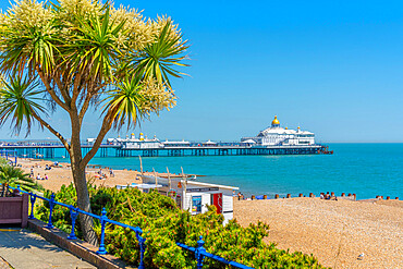View of sea front promenade, pier and beach in summer time, Eastbourne, East Sussex, England, United Kingdom, Europe