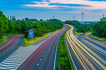 View of trail lights on the intersection of M1 and M18 Motorways at dusk in South Yorkshire, Sheffield, England, United Kingdom, Europe