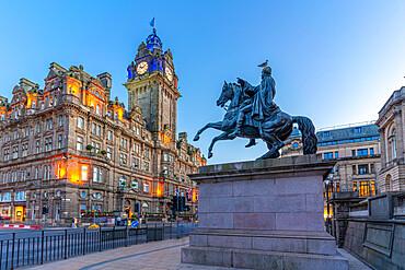View of The Balmoral Hotel and statue of Arthur Wellesley (1st Duke of Wellington) at dusk, Edinburgh, Scotland, United Kingdom, Europe