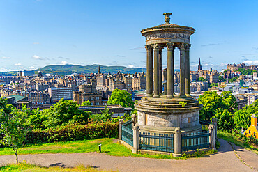 View of city centre skyline and Dugald Stewart Monument, Edinburgh, Scotland, United Kingdom, Europe